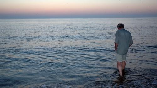 man-wading-ocean